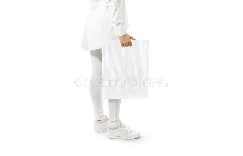 Blank white plastic bag mockup holding hand. Woman hold clear carrier sac mock up. Plain bagful branding template. Shopping carry package in persons arm royalty free stock images
