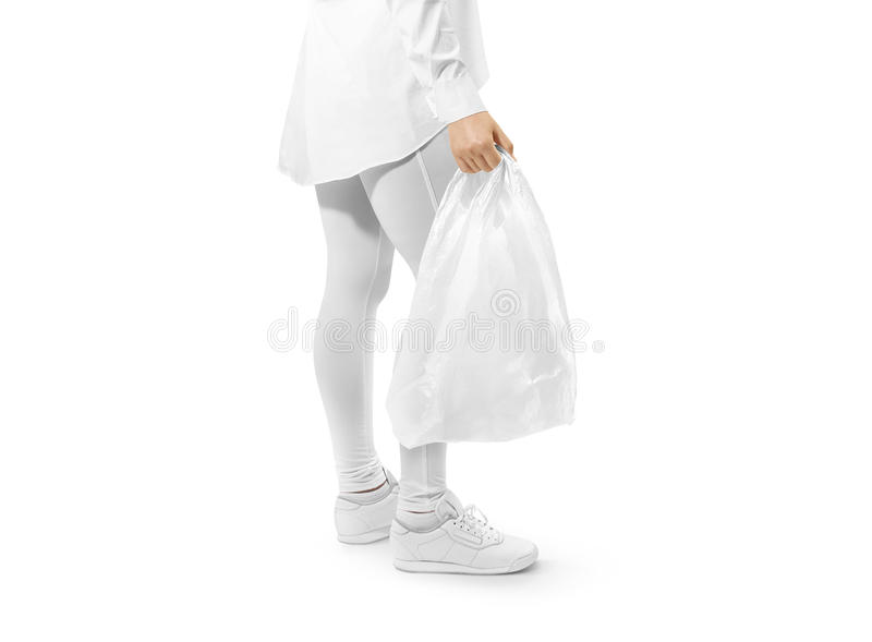 Blank white plastic bag mockup holding hand. Woman hold space carrier sac mock up. Disposable bagful branding template. Shopping carry package in persons arm royalty free stock photography