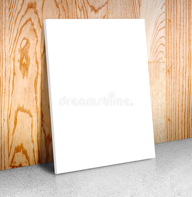 Blank white poster frame at concrete floor and wooden wall, Canvas frame template mock up for adding your content,Business concept royalty free stock photo