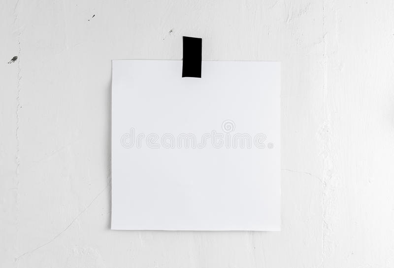 Blank white poster hanging on a tape on the wall. Template backg. Round for your design stock images