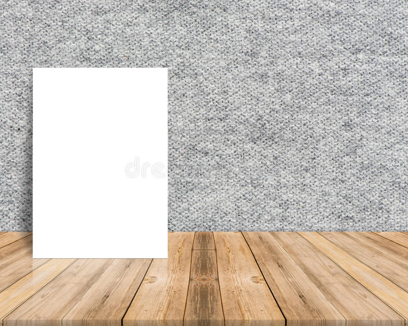 Blank white poster leaning at tropical wood table top with cloth. Wall,Mock up background for adding your content royalty free stock image