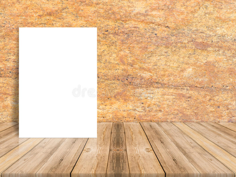 Blank white poster leaning at tropical wood table top with dark stock photography