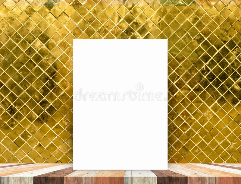 Blank white poster leaning at tropical wood table top with gold. Mosaic tile wall,Mock up background for adding content stock photo