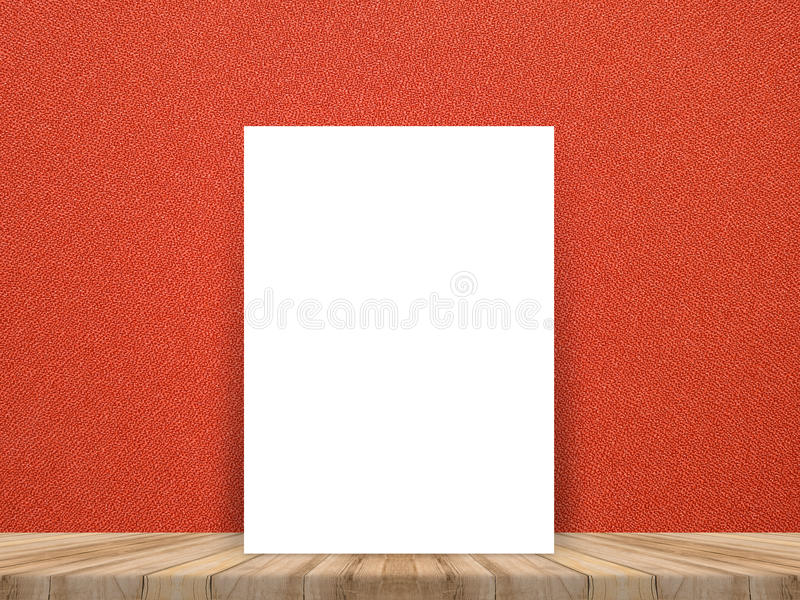 Blank white poster leaning at tropical wood table top with red c. Loth wall,Mock up background for adding your content royalty free stock photography