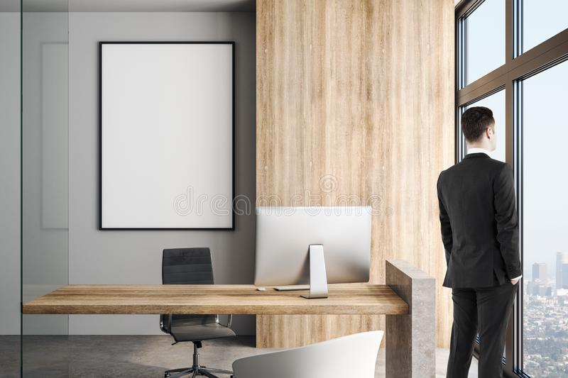 Blank white poster in modern office in skyscraper and businessman stock photography