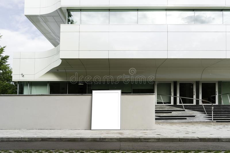 Blank white poster next to white modern business center. 3d rendering. Blank white poster next to white modern business center. Poster is on foreground and focus royalty free stock photography