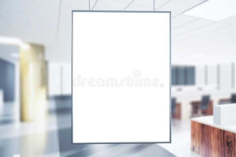 Blank white poster in the office at sunrise. Mock up royalty free stock photography