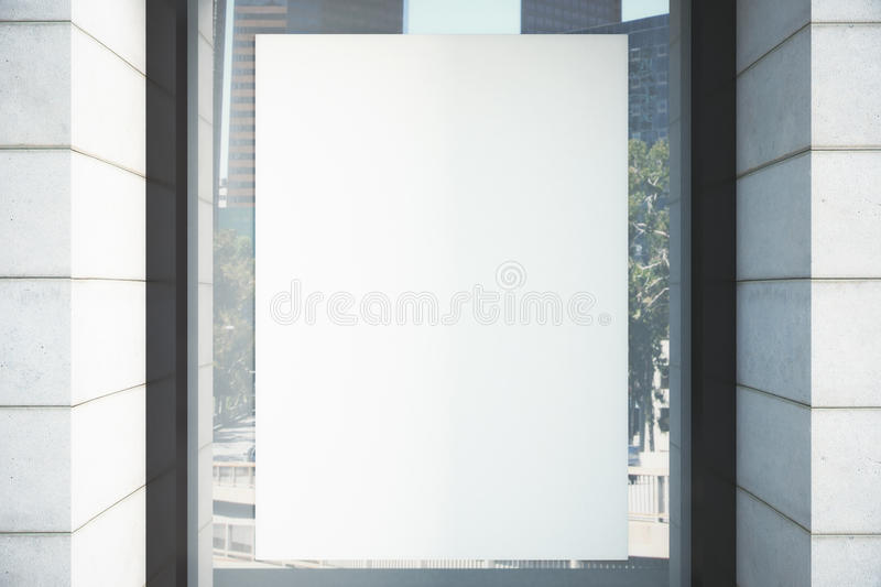 Blank white poster on the window. Mock up royalty free stock photo