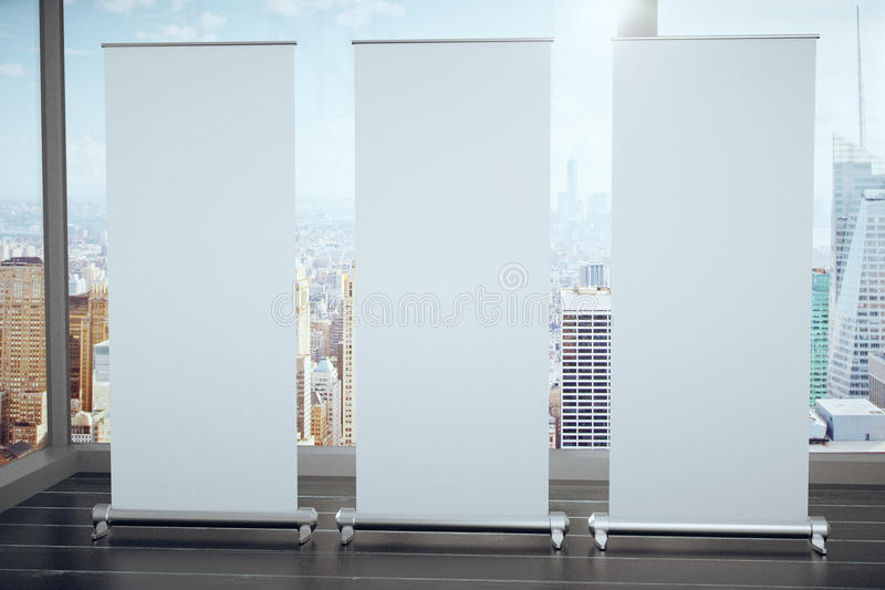Blank white posters on black wooden floor and glassy walls with stock illustration