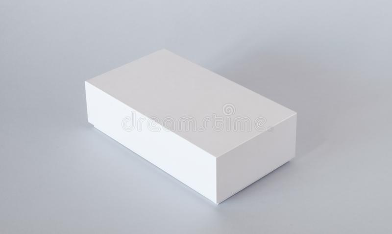 Blank White Product Package Box Mock-up. Container, Packaging Template on light background stock photo