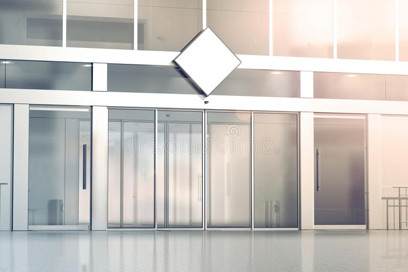 Blank white rhombus signage mockup on the store. Glass sliding doors entrance, 3d rendering. Commercial building automatic entry, banner mock up. Closed stock illustration