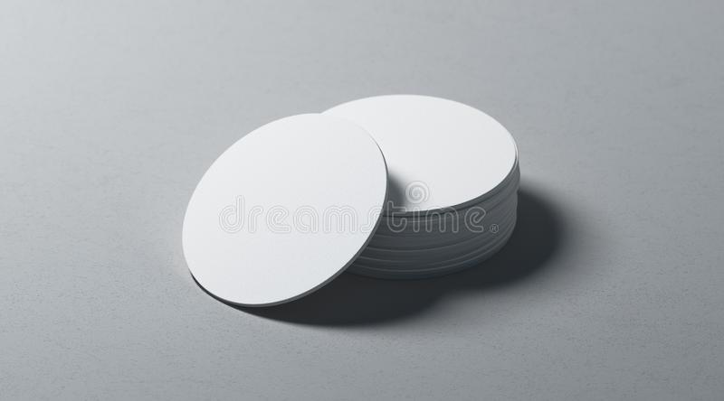 Blank white round beer coasters stack mockup on textured surface stock photography