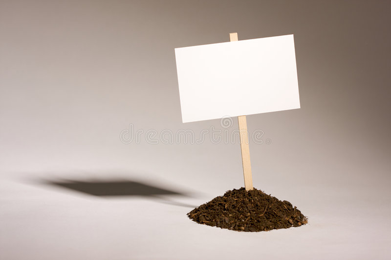 Blank White Sign in Dirt Pile stock photos