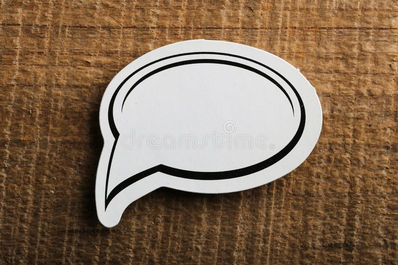 Blank White Speech Bubble Paper On Wooden Background royalty free stock images