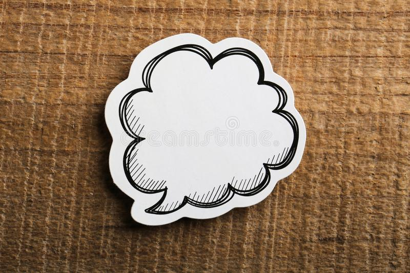 Blank White Speech Bubble Paper On Wooden Background royalty free stock photography