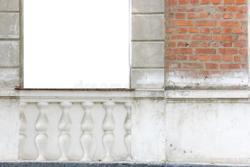 A blank white square on the old brick wall with decor. A blank white square on the old brick wall with architectural decor stock photo
