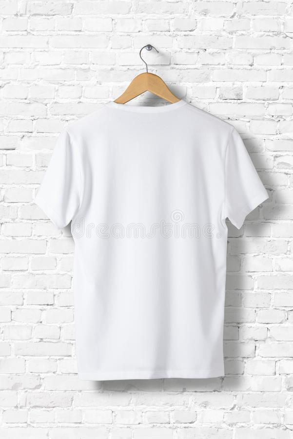 Blank White T-Shirt Mock-up hanging on white wall, rear side view. royalty free stock images