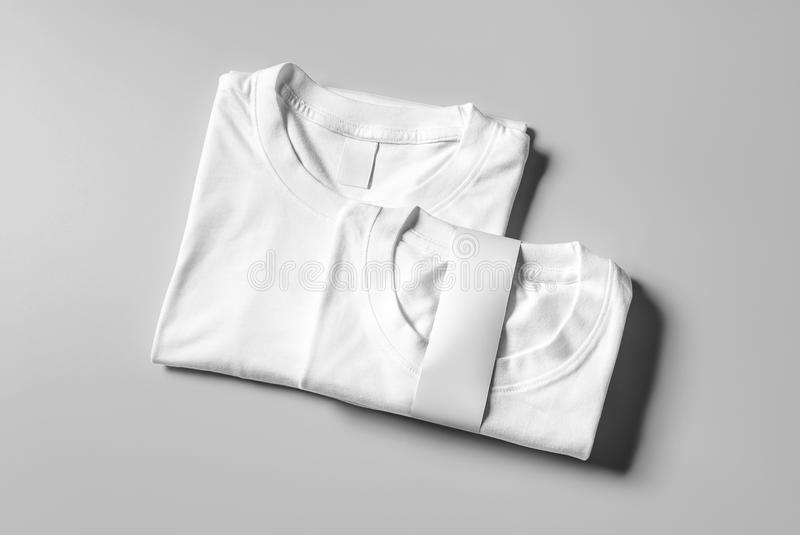 Blank White T-Shirt Mock-up hanging on white wall, front side view . Ready to replace your design stock illustration