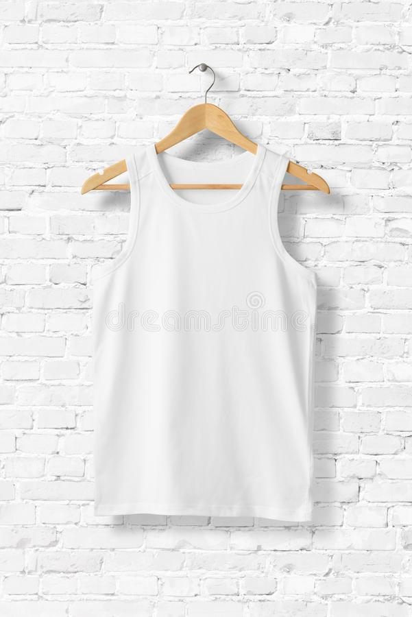 Blank White Tank Top Mock-up hanging on white wall. stock images
