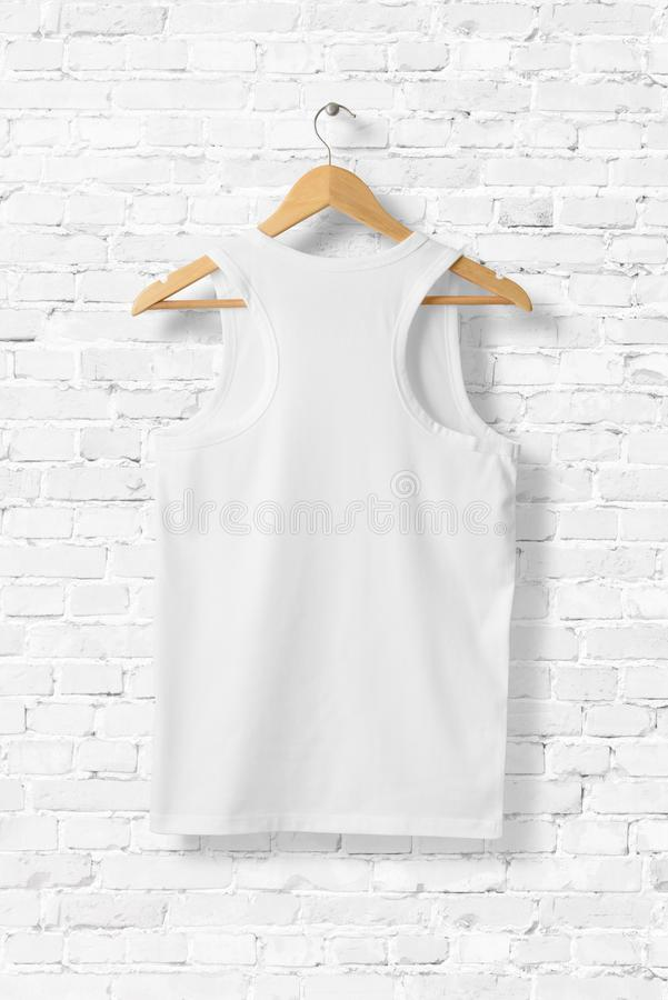 Blank White Tank Top Mock-up hanging on white wall. stock photos