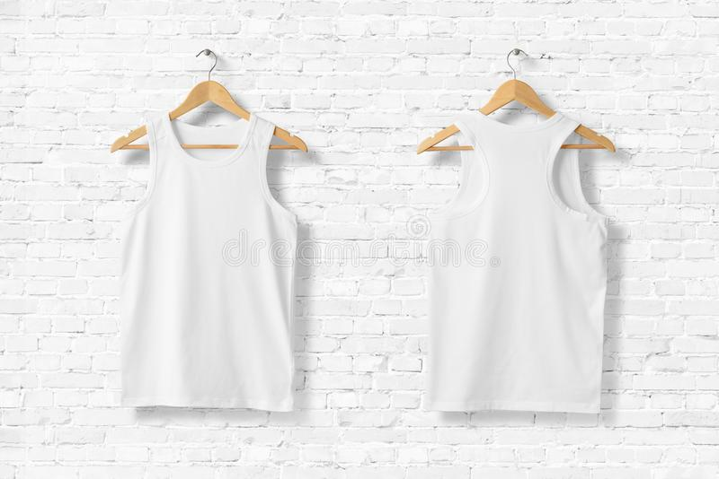 Blank White Tank Top Mock-up hanging on white wall. Rear and front view. Ready to replace with your design. 3D rendering vector illustration