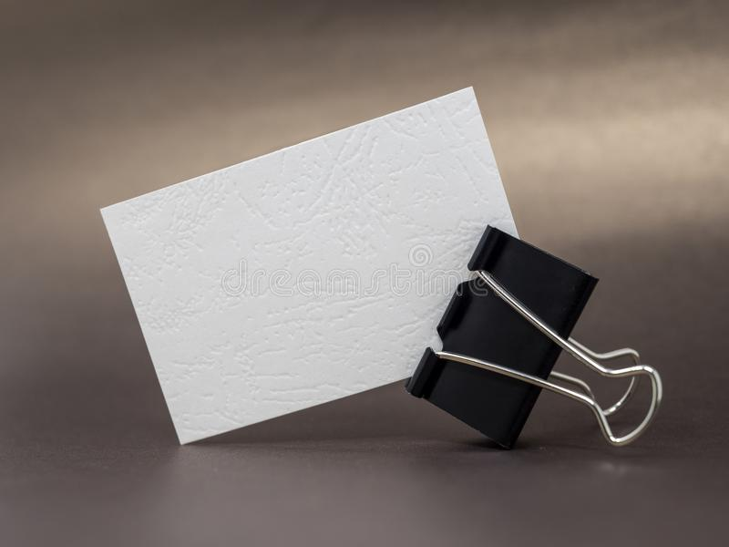 Blank Textured Business Card Held By Binder Clip On A Brown Surface ...