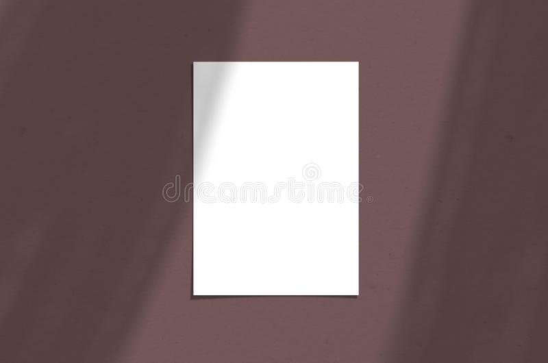 Blank white vertical paper sheet 5x7 inches with shadow overlay. Modern and stylish greeting card or wedding invitation mock up. Blank white paper sheet 5x7 stock photo