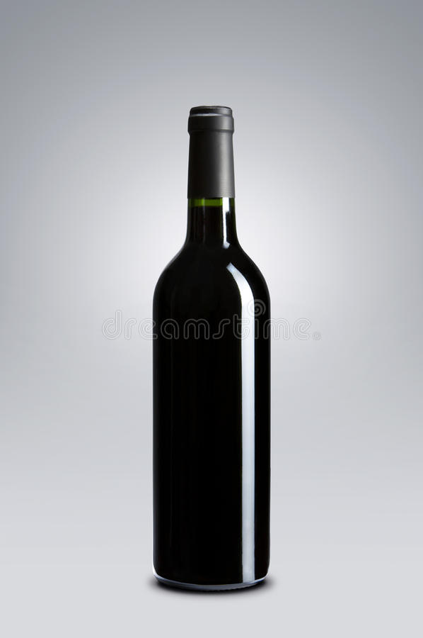 Blank wine bottle. Blank red wine bottle over gray background with copy space royalty free stock photo