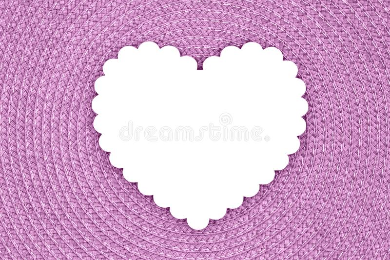 Blank wood heart on an pink textured concentric circle fabric material royalty free stock photo