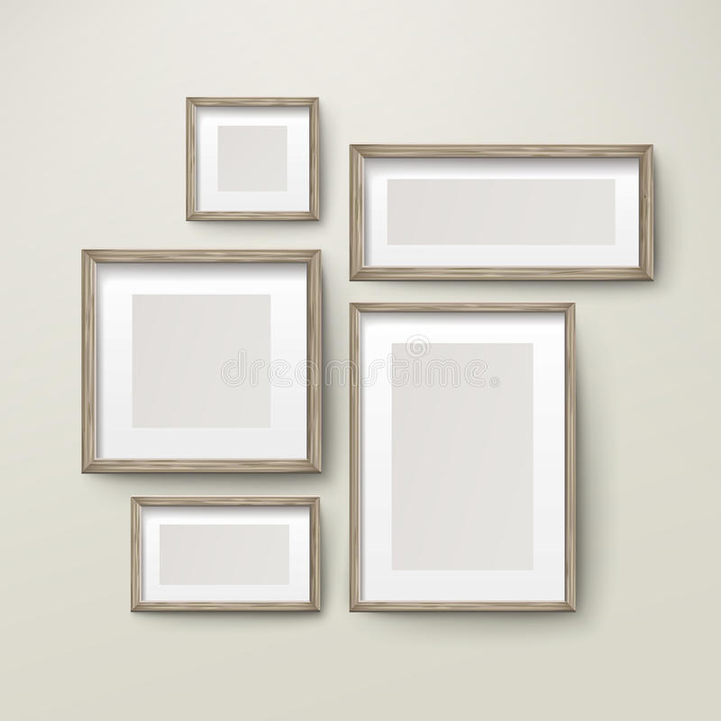 Blank wooden frames template set. On the wall royalty free illustration