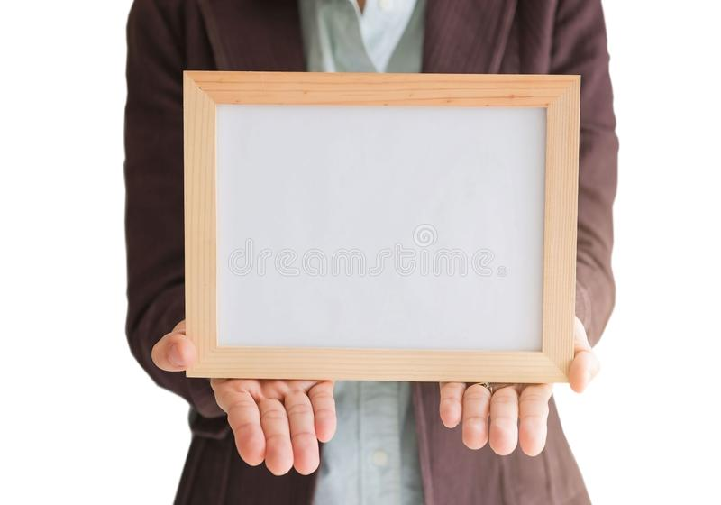 Blank wooden photo Frame in the woman`s hand isolated on white background .Blank space for text and images. Of file with Clipping Path royalty free stock photography