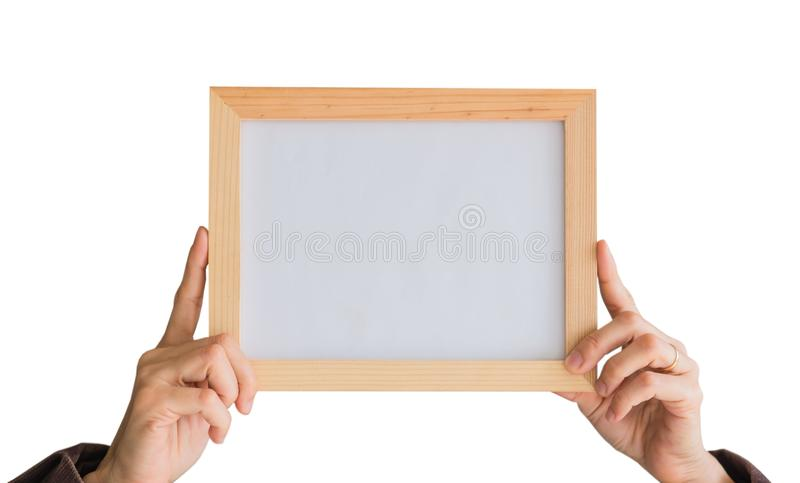 Blank wooden photo Frame in the woman`s hand isolated on white background .Blank space for text and images. Of file with Clipping Path royalty free stock images