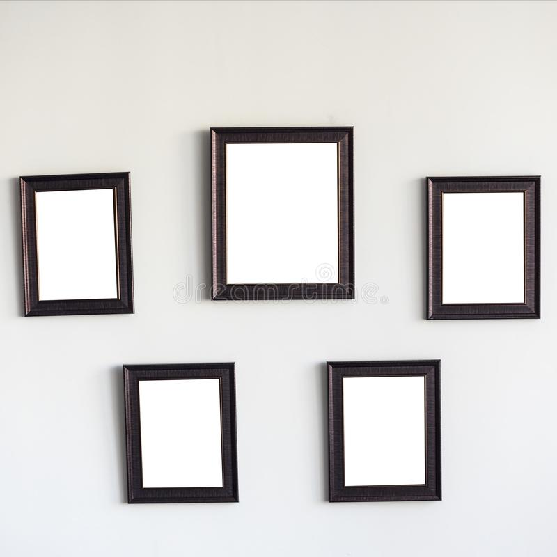 Blank wooden photo frames on the wall stock images