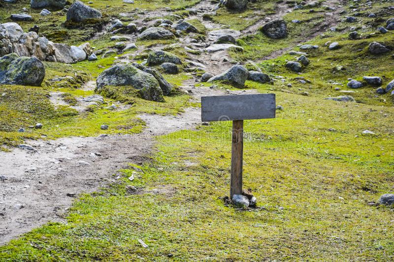 Blank wooden sign or signboard. Wooden sign or signboard along a trek. This picture was taken when I came across a beautiful brown wooden sign board during my stock photos