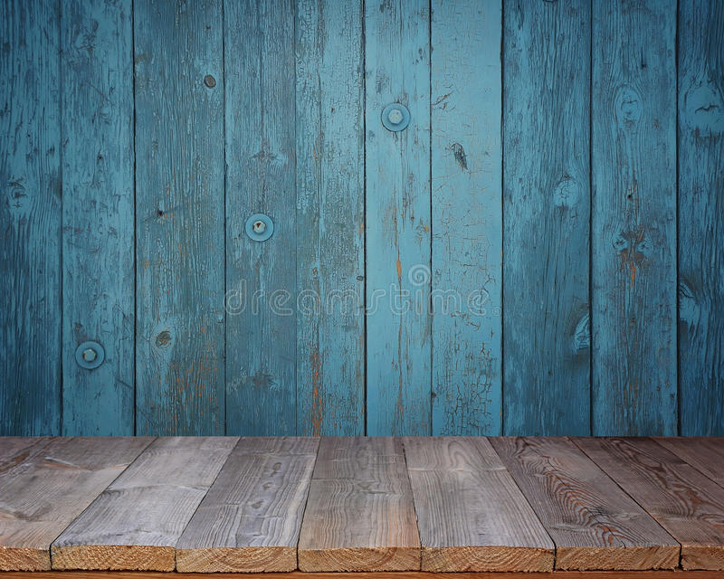 Blank wooden table on a background of the blue wall. stock image