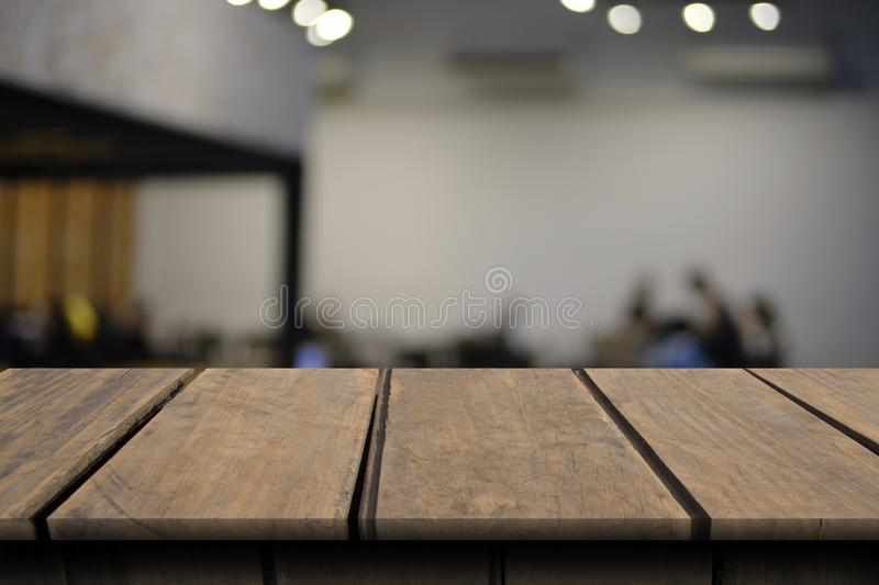 Blank wooden table of brown on front in blurred restaurant. Background stock photo