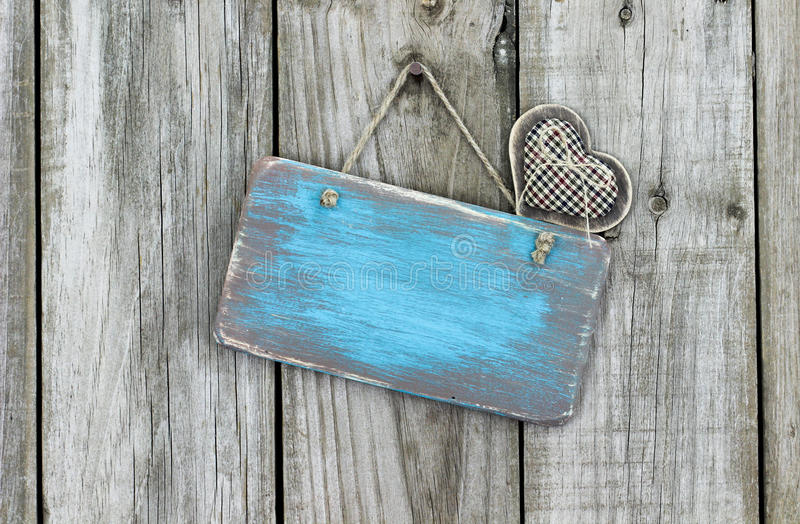 Blank Worn Sign With Heart Hanging On Rustic Fence Stock