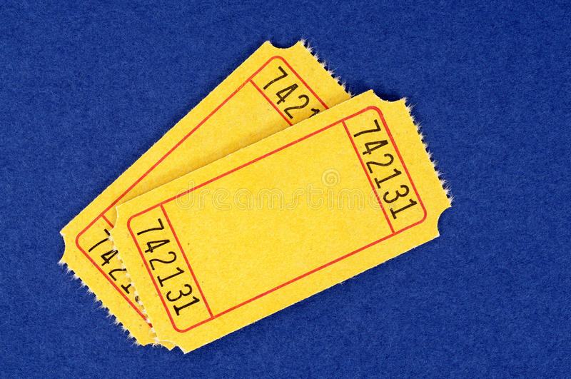 Blank yellow movie tickets, two, blue background stock photos
