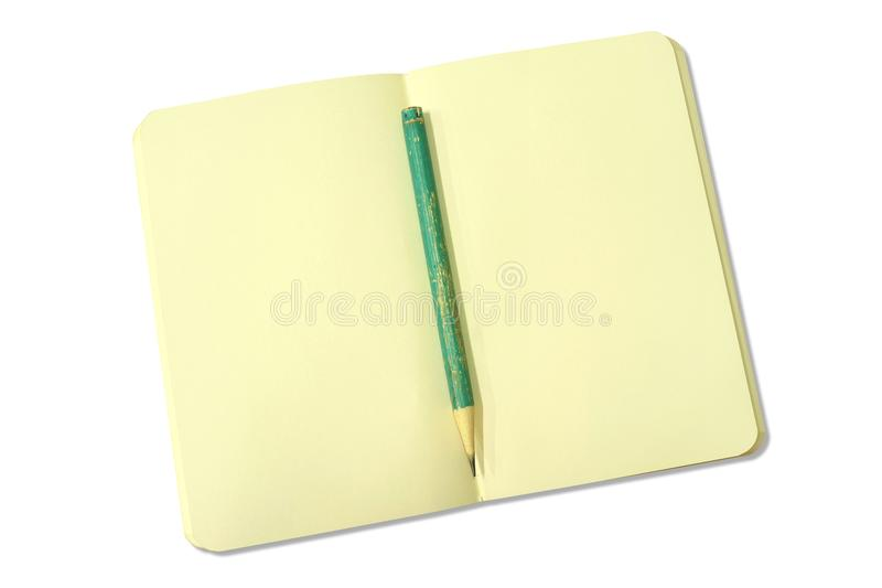 Blank yellow open notebook with green pencil isolated on white royalty free stock images