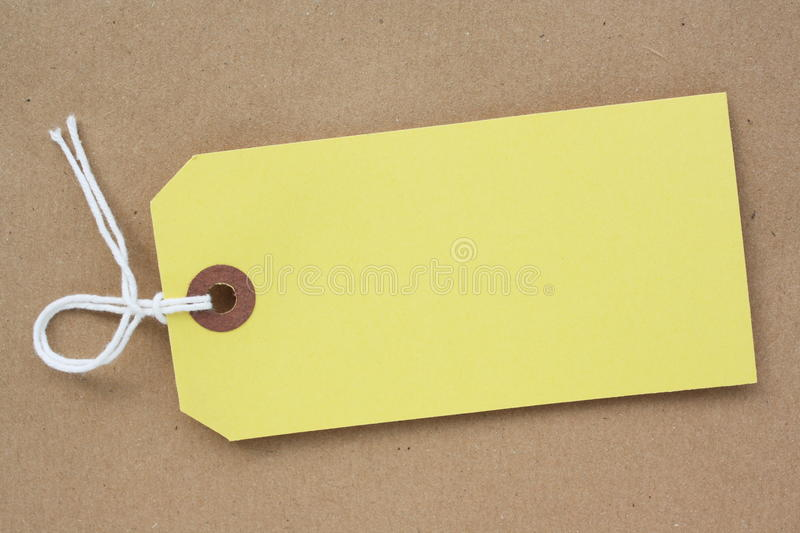 Download Yellow Paper Luggage Tag stock photo. Image of blank - 30102540