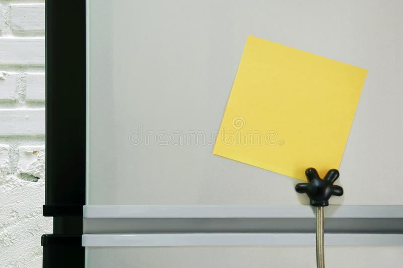 Blank Yellow Paper Note Sticked on Refridgerator Door for Add Text Message stock photo