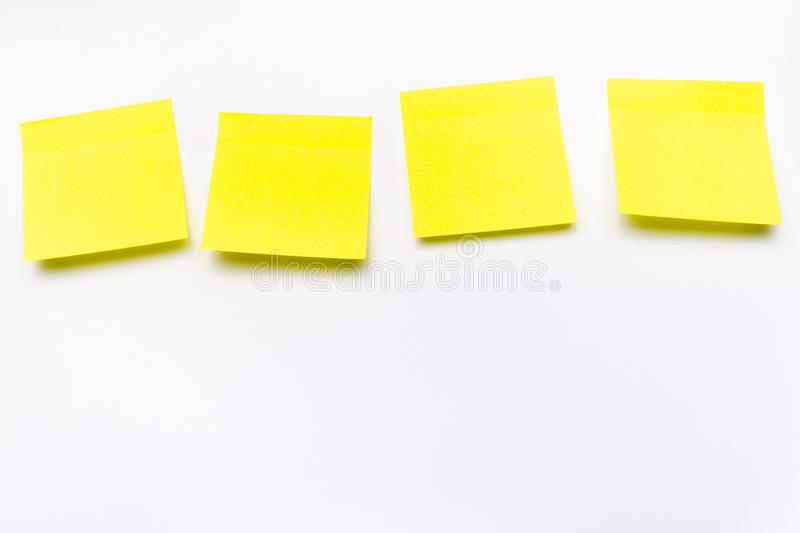 Blank yellow paper stickers on white background stock photo