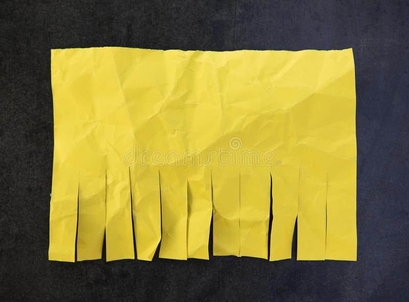 Blank yellow paper. With tear off tabs stock image