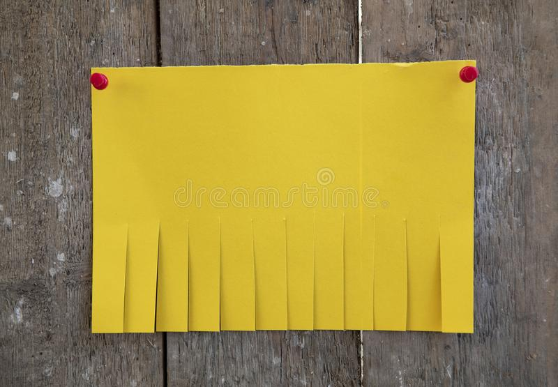 Blank yellow paper. With tear off tabs stock photo