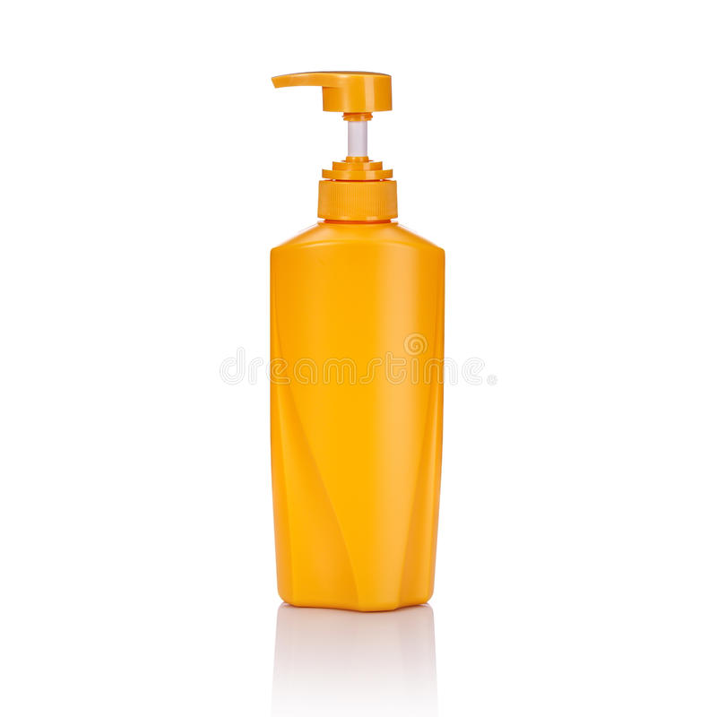 Blank yellow plastic pump bottle used for shampoo or soap. Studio shot isolated on white. Background royalty free stock photo