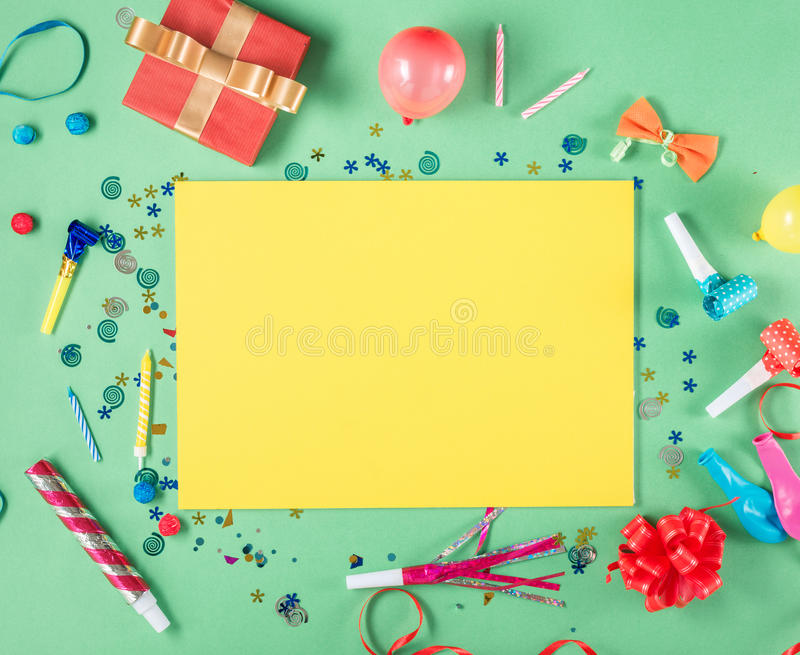 Blank yellow sheet of paper with birthday items stock photos