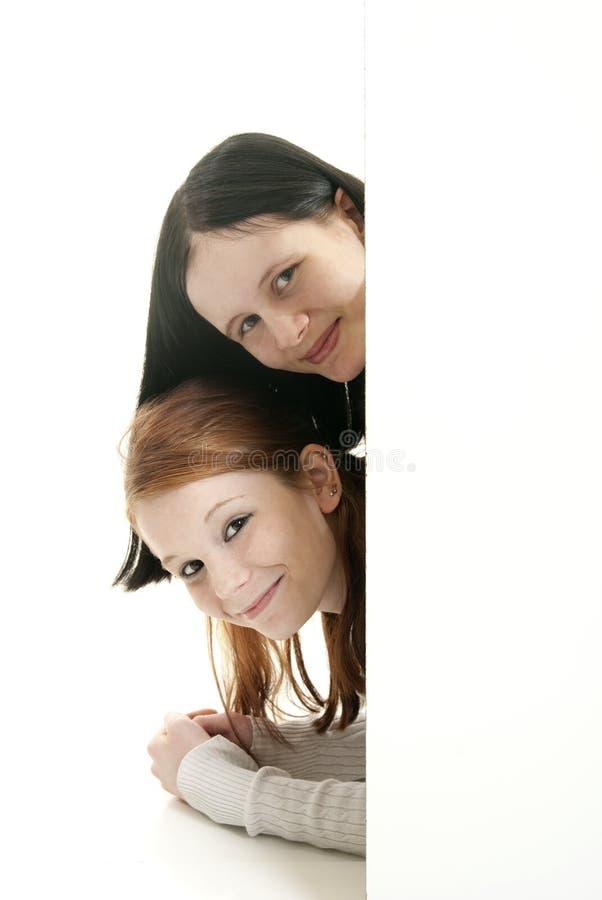 blanka flickor undertecknar att le som är teen arkivbild