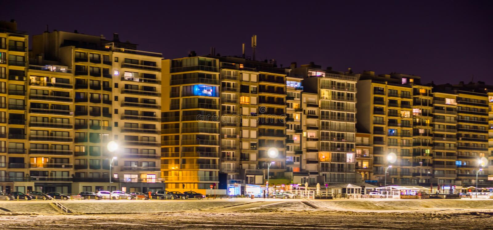 Blankenberge boulevard lighted at night, view on the beach and apartment buildings, touristic city in Belgium stock images