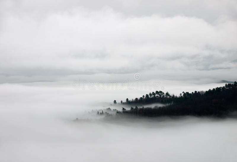 Blanket of fog and hills - birdseye view royalty free stock photo