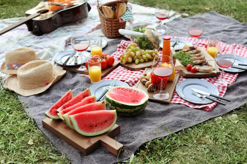 Blanket with food prepared for summer picnic royalty free stock images
